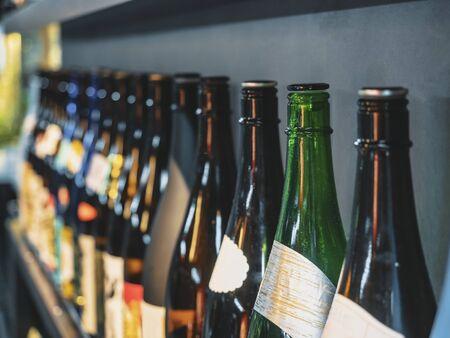 Photo pour Sake bottles Japanese Alcohol drink Bar background - image libre de droit