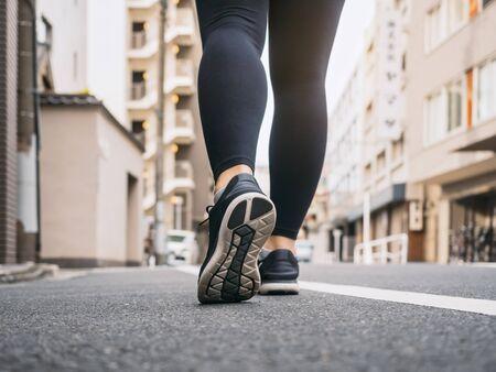 Photo pour Woman walking on City street morning exercise Travel explorer - image libre de droit