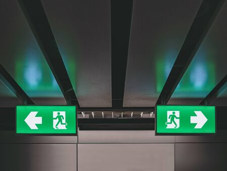 Foto de Exit Sign direction indoor building Light box Way out signage Conceptual - Imagen libre de derechos