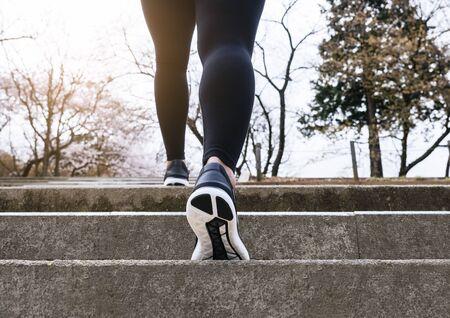 Photo pour Woman Walking on stair step Park Outdoor Jogging exercise - image libre de droit