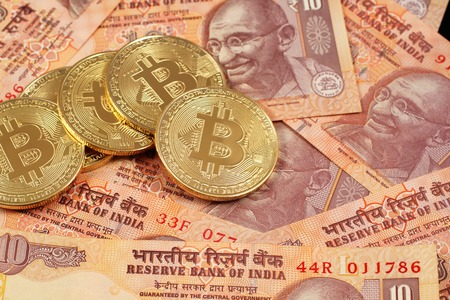 Photo for A close up image of bitcoins with Indian rupee notes - Royalty Free Image