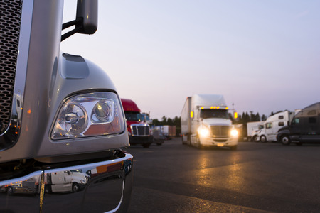 Photo for Fragment of the modern parts of the truck on a night truck stop in the foreground - Royalty Free Image