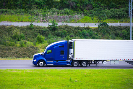 Foto de Profile of rapid road beast in the form of modern powerful truck  - Imagen libre de derechos