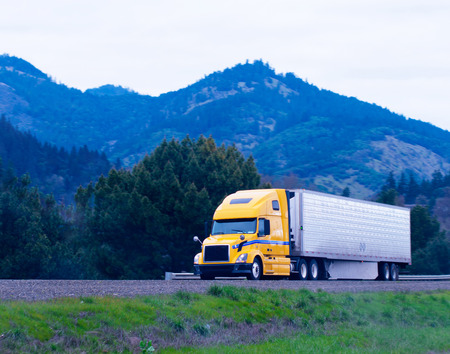 Photo for Modern popular powerful yellow big rig semi truck  - Royalty Free Image