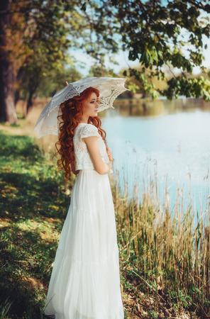 Dreams. Vintage beautiful woman admiring nature