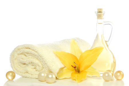 spa composition with massage oil isolated on white background
