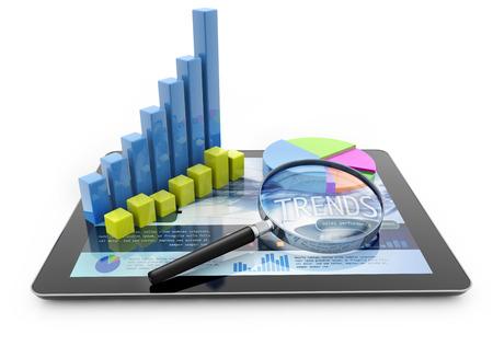 Foto de graphs and magnifier over a portable computer on white background - Imagen libre de derechos