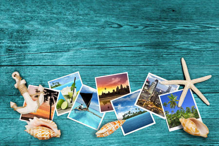 Foto de travel photos and seashells on azure wood background - Imagen libre de derechos