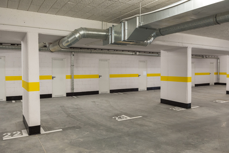 Foto de Typical underground car parking garage in a modern apartment house. - Imagen libre de derechos