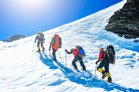 Photo pour Group of climbers reaching the summit. Extreme sport - image libre de droit