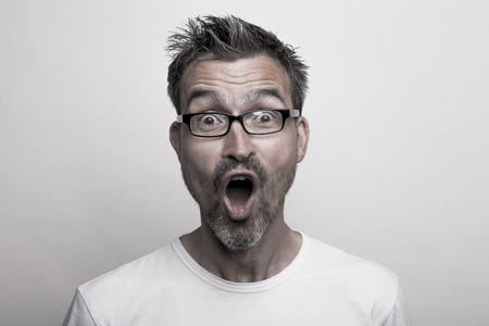 Photo for Portrait of an enthusiastic man with glasses and stubbly beard - Royalty Free Image