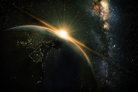 Foto de sunrise view of earth from space with milky way galaxy - Imagen libre de derechos