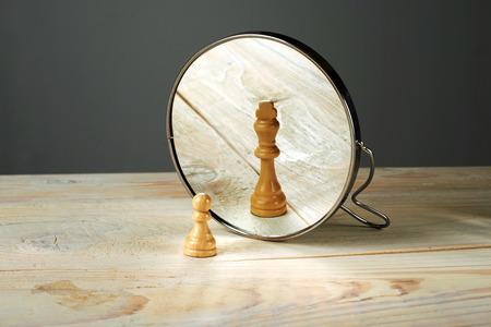 Foto de Alter ego. Be someone else, a soldier and a king chessmen mirroring. - Imagen libre de derechos