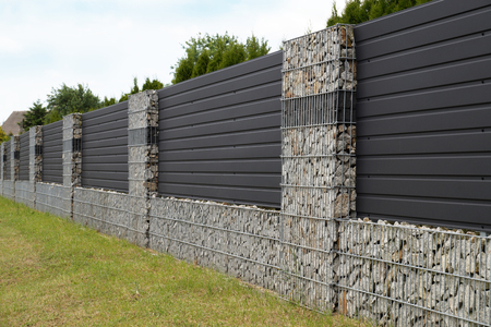 Foto de A modern form of house fencing. Gabions, steel galvanized nets filled with split stone - Imagen libre de derechos