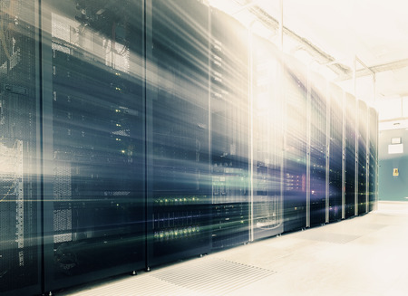Foto de abstract room with rows of server hardware in the data center - Imagen libre de derechos