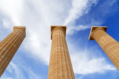 Photo pour Three ancient greek pillars against a blue sky - image libre de droit