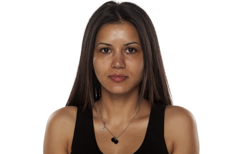 Photo for Serious young dark-skinned pretty woman without makeup - Royalty Free Image