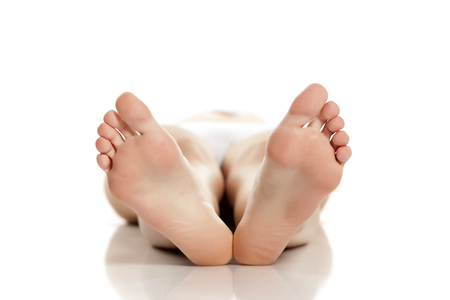 Foto de female bare feet on white background - Imagen libre de derechos
