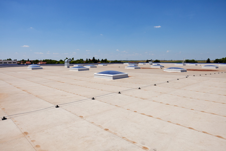 Foto de Flat roof with skylight and hydro insulation membranes - Imagen libre de derechos