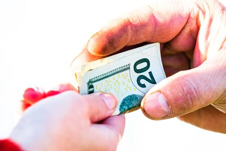 Photo for Hand giving money isolated, hard worked hand taking dollars money. Currency transfer on white background. - Royalty Free Image