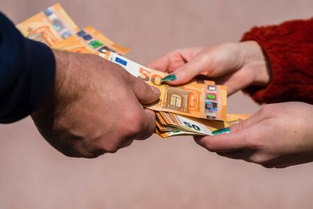 Photo for Hand giving money like bribe or tips or salary isolated, hard worked hand taking euro banknotes. Currency transfer and reward for hard work. - Royalty Free Image