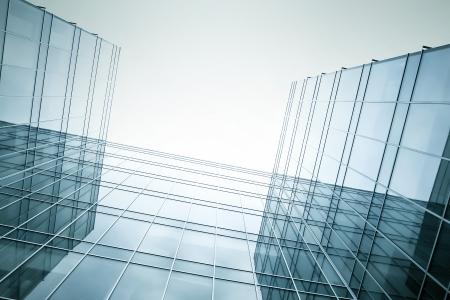 Foto de disappearing luminosity glass office buildings in the morning, wide angle view - Imagen libre de derechos