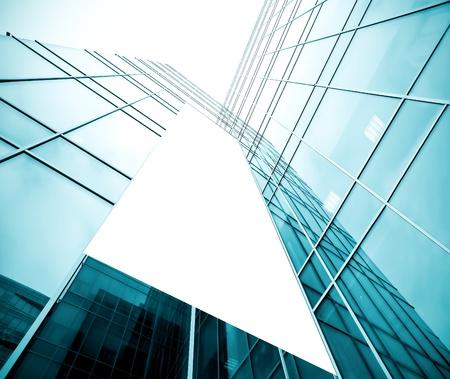 Foto de blank billboard over glassy building texture - Imagen libre de derechos