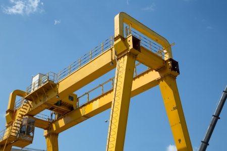 Photo for Yellow Gantry Bridge Crane for Cargo and Construction - Royalty Free Image