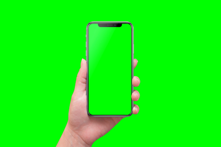 Photo for Modern smart phone in hand close-up. Isolated screen and background in green. - Royalty Free Image