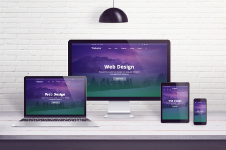 Photo pour Responsive web site on multiple different display devices. Concept of web design, development work desk. - image libre de droit