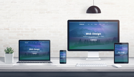 Foto per Modern flat design, responsive web site on multiple devices. Concept of web development studio work desk. - Immagine Royalty Free