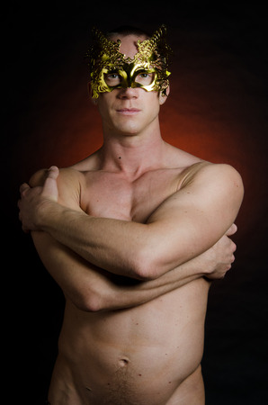 Photo for Sexy man in the mask. Carnival. Sexy naked man in a gold mask. - Royalty Free Image
