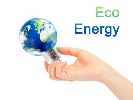 Hand holds Earth in light bulb. Alternative energy concept