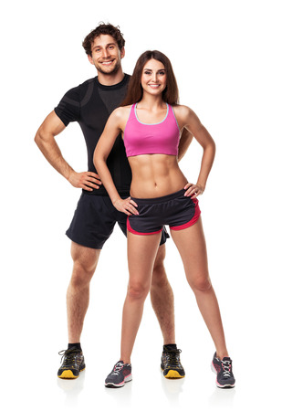 Photo pour Athletic couple - man and woman after fitness exercise on the white background - image libre de droit