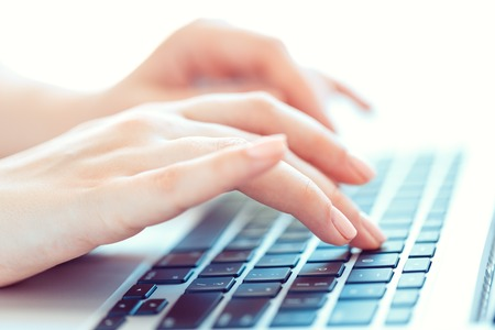 Photo pour Female hands or woman office worker typing on the keyboard - image libre de droit