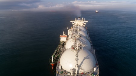 Photo for Top view of a large LNG tanker and a tanker standing side by side. - Royalty Free Image