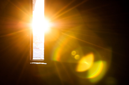 Photo for Rays of sun through the small window in the castle - Royalty Free Image