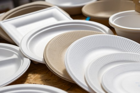 Photo for a variety of paper disposable plates of different colors - Royalty Free Image