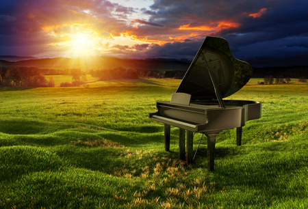 Photo for Black glossy piano on the meadow under the dramatic sky with sunny lights. Photos montage with 3D render illustration. - Royalty Free Image