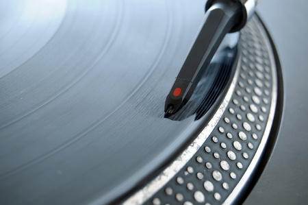 DJ record needle on a 12 inch vinyl LP playing hiphop techno rave beats.