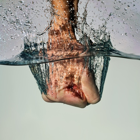 Photo for fist punching water - Royalty Free Image