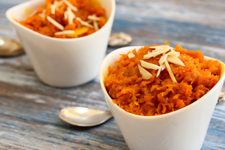 Photo for Carrot halwa - Diwali sweet made of carrots milk and sugar in white bowl - Royalty Free Image