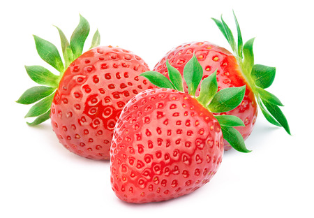 Foto de Three perfectly cleaned strawberries with leaves isolated on the white background with clipping path - Imagen libre de derechos