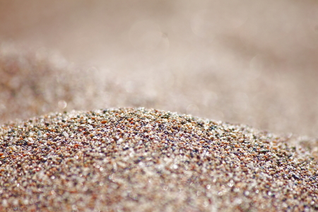 Foto de Sea run-multicolored sand on the beach close-up. - Imagen libre de derechos