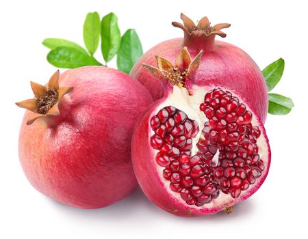 Photo pour Juicy opened pomegranate with leaves. Isolated on a white background.  - image libre de droit