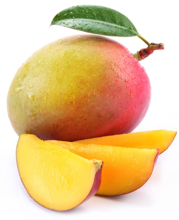 Foto de Mango with slices on a white background. - Imagen libre de derechos