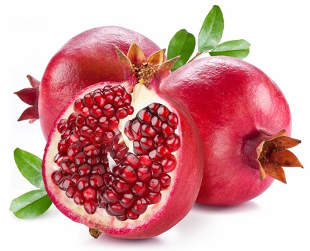 Photo pour Ripe pomegranates with leaves isolated on a white background. - image libre de droit