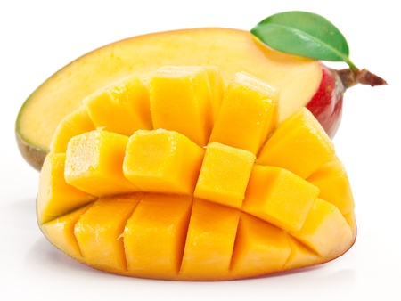 Foto de Mango with slices on a white background  - Imagen libre de derechos