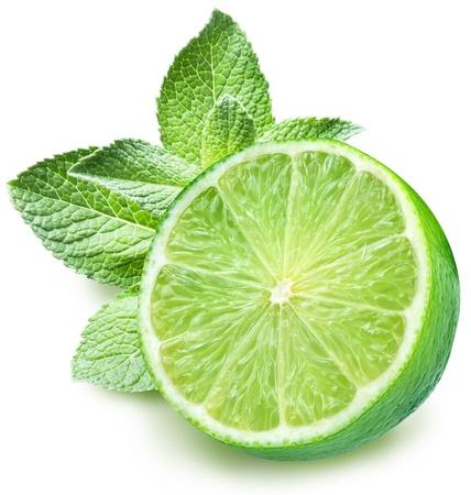 Foto de Lime and mint on a white background  - Imagen libre de derechos