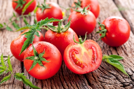 Photo pour Tomatoes, cooked with herbs for the preservation on the old wooden table. - image libre de droit